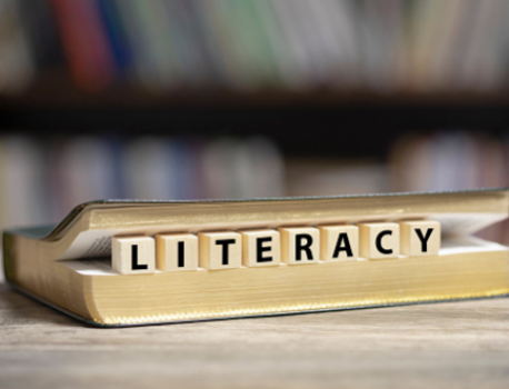 What is literacy and what does it have to do with coding?